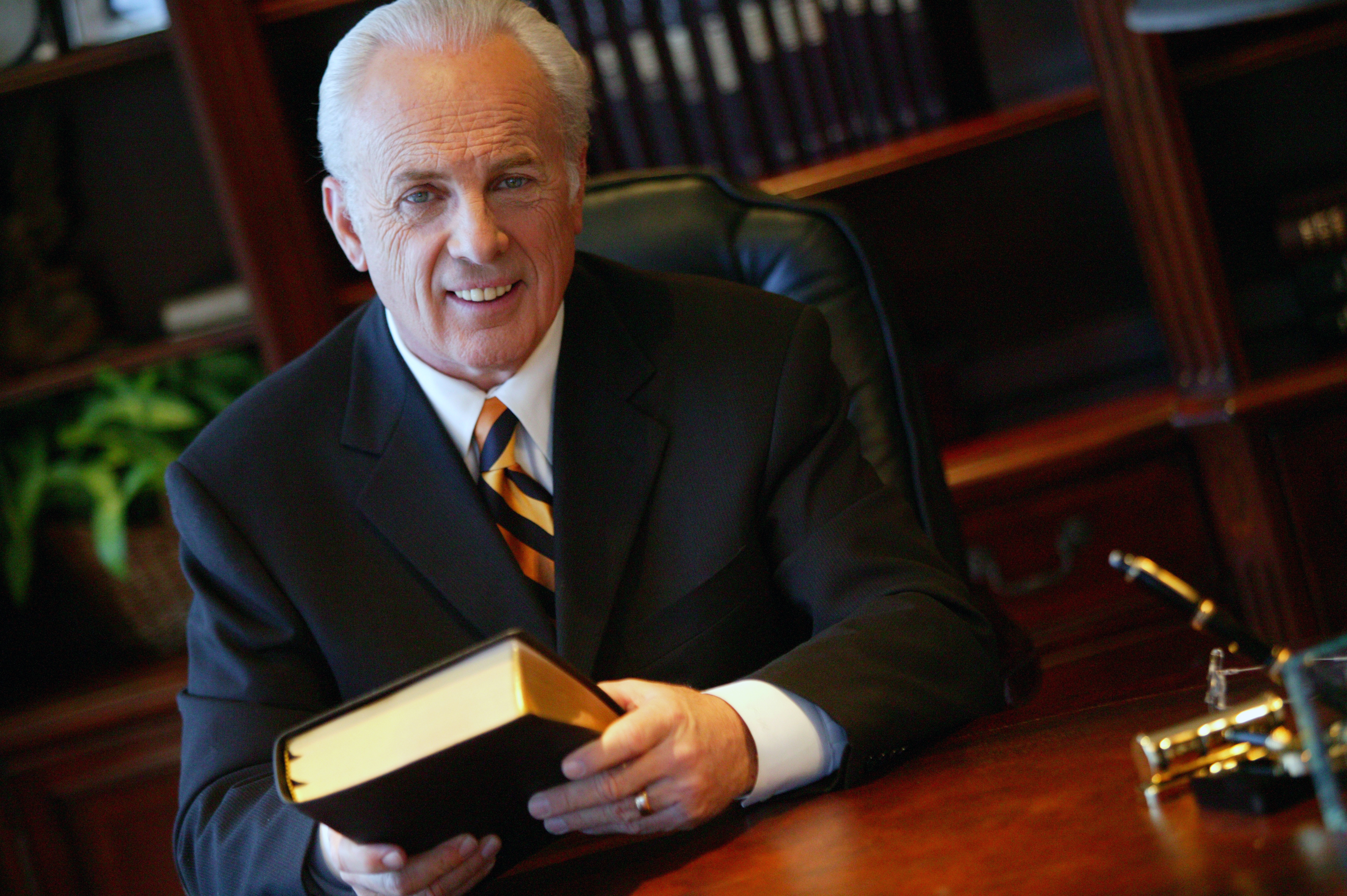 John MacArthur with Bible